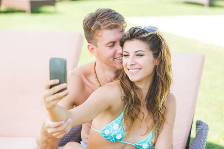 Young Couple on Vacation Taking Selfie photo
