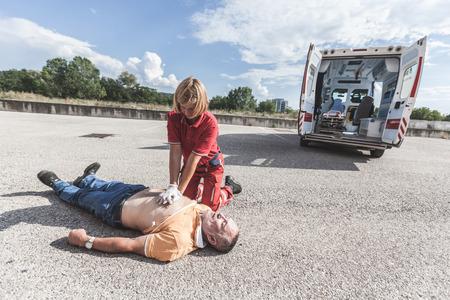 rescuer: Rescuer Practicing Heart Massage