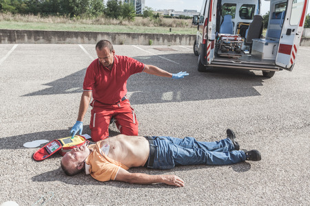 Doctor Providing First Aid with a Defibrillator Stok Fotoğraf