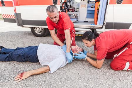 providing: Rescue Team Providing First Aid