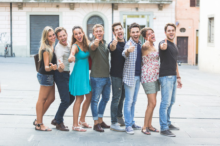 Group of Friends with Thumbs Up photo