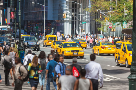 5th: NEW YORK, USA - AUGUST 28, 2014: Crowded 5th Avenue with tourists on sidewalk and yellow cabs on the street. Editorial