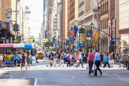 NEW YORK, USA - AUGUST 28, 2014: Crowded 5th Avenue with tourists crossing the street on zebra Editorial