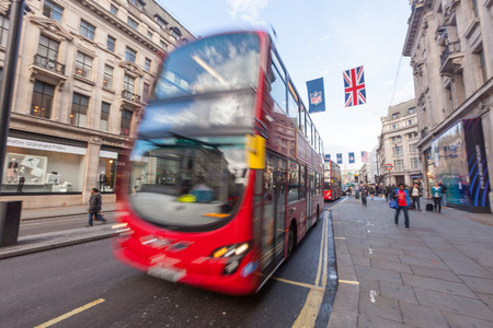 doubledecker: LONDON, UNITED KINGDOM - OCTOBER 25, 2013: Famous Double-Decker Red Bus next to Oxford Circus with people crossing the street on background.