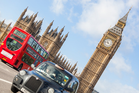 london big ben: LONDON, UNITED KINGDOM - OCTOBER 27, 2013: Famous Black Cab on Westminster Bridge with Big Ben and Palace of Westminster on background Editorial