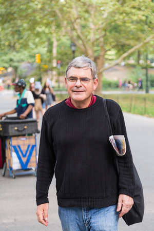 greying: Retired Senior Man at Park, Walking and Relaxing, Smiling Expression