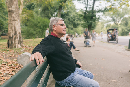 greying: Retired Senior Man at Park, Seated on a Bench