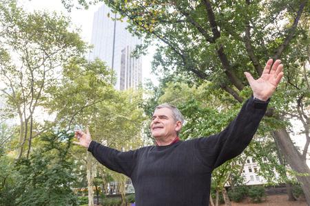 greying: Portrait of Retired Senior Man at Park, Freedom Feelings Stock Photo