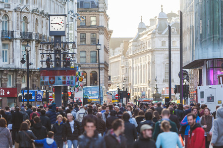 british people: LONDON, UNITED KINGDOM - OCTOBER 30, 2013: Leicester Square crowded with tourists and commuters at sunset