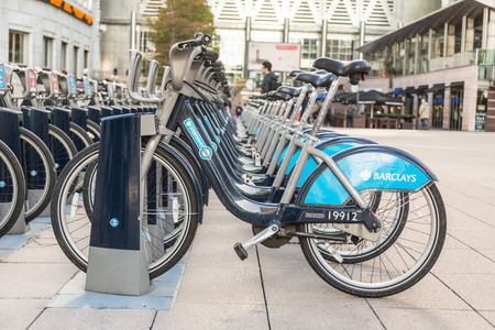 rack wheel: LONDON, UNITED KINGDOM - OCTOBER 30, 2013: Barclays Cycle Hire docking station in Canary Wharf district.