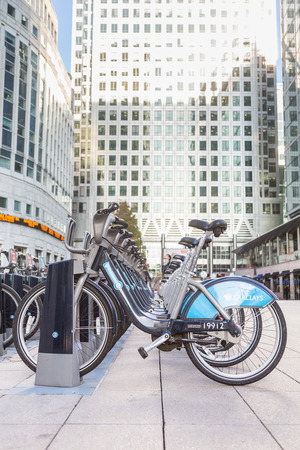docking: LONDON, UNITED KINGDOM - OCTOBER 30, 2013: Barclays Cycle Hire docking station in Canary Wharf district.
