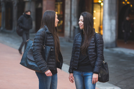 twin house: Female Twins Talking Each Other at City Square.