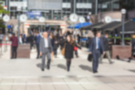 intentionally: Commuters in Canary Wharf, financial district of London, blurred background