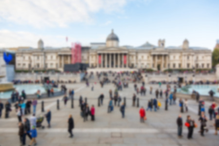 intentionally: Crowded Trafalgar Square with National Gallery, blurred background
