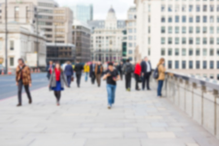 busy street: Blurred background, tourists and commuters walking on London Bridge Stock Photo