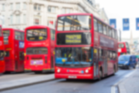 intentional: Blurred background with famous London public transport vehicles
