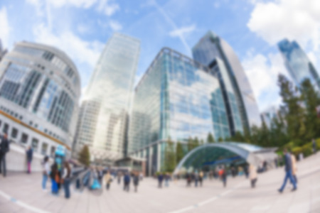 Commuters in Canary Wharf, financial district of London, blurred background