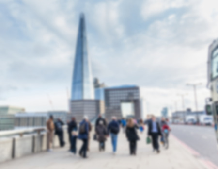 intentionally: Blurred background, tourists and commuters walking on London Bridge Stock Photo