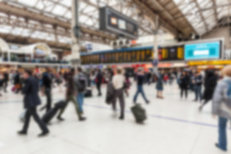 intentionally: Crowded station during rush hour in London, blurred background