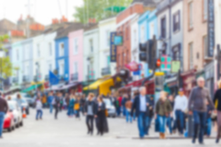intentionally: Crowded Portobello road, a famous area in London, blurred background