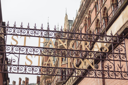 pancras: St Pancras station sign with building on background in London Editorial