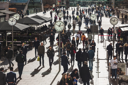 canary wharf: LONDON, UNITED KINGDOM - MARCH 6, 2015: Commuters an tourists in Canary Wharf, modern financial district of the city Editorial