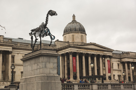 plinth: LONDON, UNITED KINGDOM - MARCH 8, 2015: Gift Horse, the new sculpture on the Fourth Plinth in Trafalgar Square, with National Gallery on background Editorial