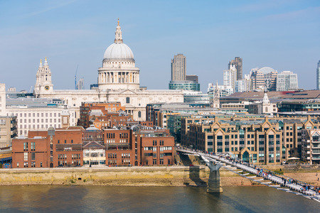 millennium: St Paul Cathedral and Millennium Bridge in London. Photo taken on a sunny day with blue sky.