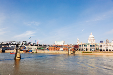 St Paul Cathedral and Millennium Bridge in London. Photo taken on a sunny day with blue sky. photo