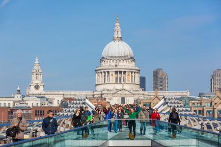 LONDON, UNITED KINGDOM - MARCH 11, 2015: People on Millennium Bridge with St. Paul Cathedral on background