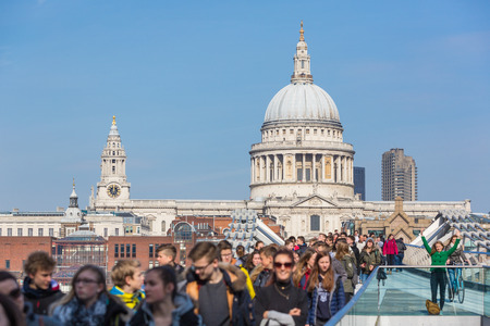 millennium bridge: LONDON, UNITED KINGDOM - MARCH 11, 2015: People on Millennium Bridge with St. Paul Cathedral on background Editorial