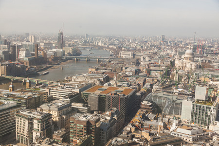 millennium wheel: London aerial view with Thames and St Paul cathedral. On the left side of the photo there are also the Millennium Wheel and the Big Ben. Stock Photo