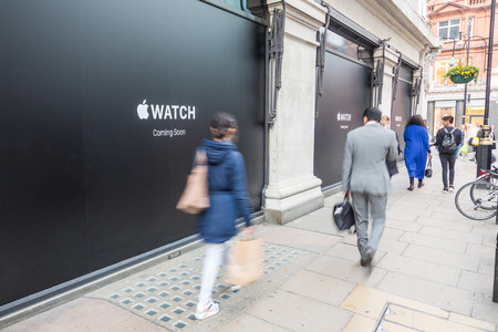 coming soon: LONDON, UK - APRIL 08, 2015: Apple Watch store sign at Selfridges in Oxford street with people walking on sidewalk. It will be one of first three official stores in the world, opening on April 10th. Editorial