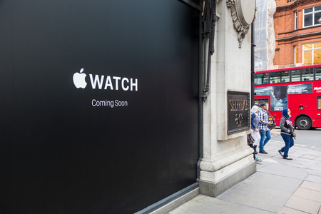 oxford street: LONDON, UK - APRIL 08, 2015: Apple Watch store sign at Selfridges in Oxford street with people walking on sidewalk. It will be one of first three official stores in the world, opening on April 10th. Editorial
