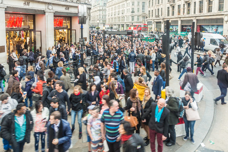delays: LONDON, UK - APRIL 08, 2015: Crowded Oxford Circus Station entrance due to severe delays in the tube Central Line. Lots of commuters and tourists waiting on the street to enter the station.
