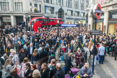 underground: LONDON, UK - APRIL 08, 2015: Crowded Oxford Circus Station entrance due to severe delays in the tube Central Line. Lots of commuters and tourists waiting on the street to enter the station.