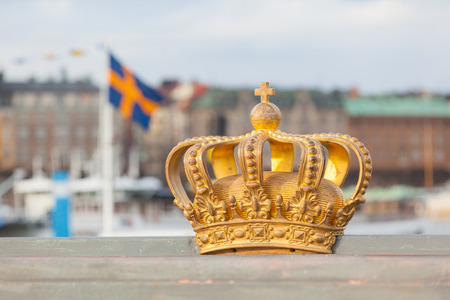 sweden flag: Golden crown with swedish flag on background in Stockholm. Stock Photo