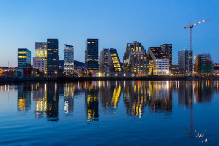 Modern buildings in Oslo at twilight.