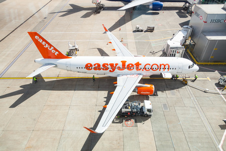 airbus: LONDON, UK - MAY 7, 2015: EasyJet airlines Airbus A320 at Gatwick LGW airport while refueling.