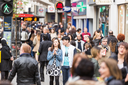 commuters: LONDON, UNITED KINGDOM - APRIL 17, 2015: Crowded sidewalk on Oxford Street with commuters and tourists from all over the world. Editorial