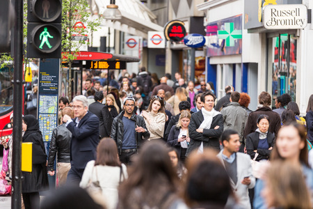 LONDON, UNITED KINGDOM - APRIL 17, 2015: Crowded sidewalk on Oxford Street with commuters and tourists from all over the world. Editoriali