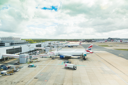 airways: LONDON, UK - MAY 7, 2015: British Airways Boeing 777 at Gatwick LGW airport during refueling operations