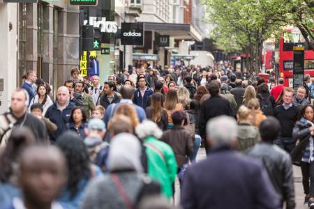 LONDON, UNITED KINGDOM - APRIL 17, 2015: Crowded sidewalk on Oxford Street with commuters and tourists from all over the world. Editorial