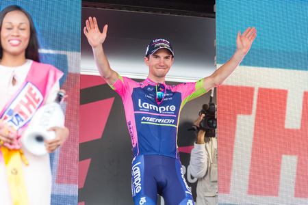exultation: ABETONE, ITALY - MAY 13, 2015: Jan Polanc, team Lampre Merida, on the podium after winning the 5th stage of Giro dItalia