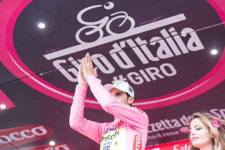 exultation: SESTRIERE, ITALY - MAY 30, 2015: Alberto Contador, team Saxo Tinkoff, wearing pink jersey maglia rosa at the end of the 20th stage of Giro dItalia