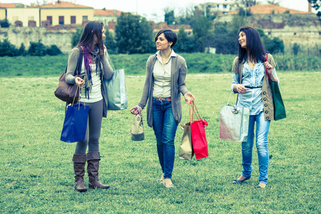 after shopping: Young Women at Park after Shopping Stock Photo