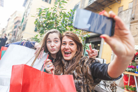 after shopping: Happy Women Taking Selfie after Shopping