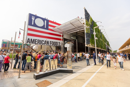 exhibition crowd: MILAN, ITALY - JUNE 01, 2015: Exterior view of USA pavilion at Expo 2015 with a lot of persons waiting in the queue.