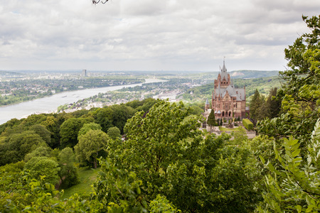 rhine westphalia: Schloss Drachenburg, Dragon Castle in english, with city of Bonn in background and all the Rhine valley. Editorial