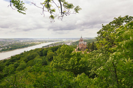 schloss: Schloss Drachenburg, Dragon Castle in english, with city of Bonn in background and all the Rhine valley. Stock Photo